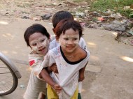 Yangon. The mud (Thanka) on the faces is made from ground bark was seen on many children and women. It is for protection of the skin as well as a beautify their faces.