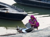 Cleaning dishes in the Ganges River, Varanasi.