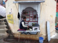 Microbusiness. His shop was basically a hole in the wall.