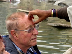 Fellow traveler Stu getting a bindi applied by a Hindu Priest during our boat ride along the Ganges on New Years Day.