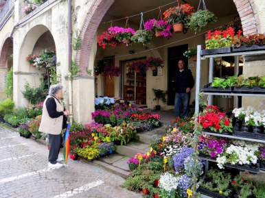 The garden shop. Just loved this cute lady with her rainbow umbrella. Greve in Chianti