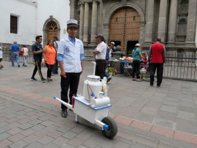 Street vendor in Quito. We stopped and tried his treat...like a meringue with a fruit sauce drizzled on top